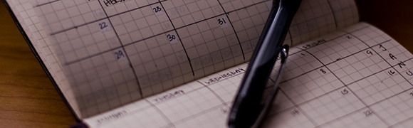 Calendar and a black pen